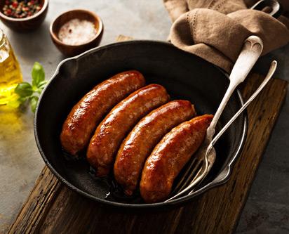 Visuel de la cuisson des saucisses fumées Madrange à la poêle